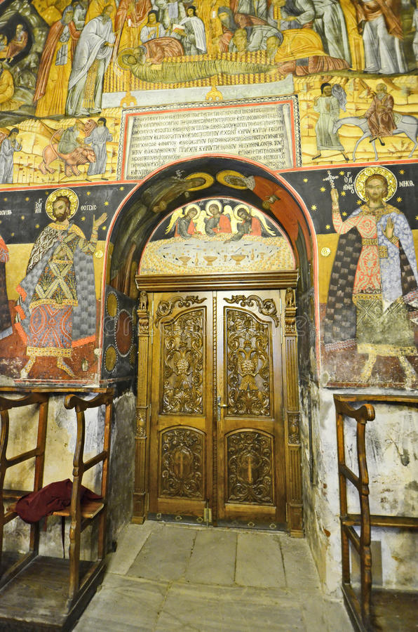 Bulgaria, Bachkovo. Bulgaria, decorated door and wall painting in public Bachkovo monastery, landmark and pilgrimage site stock photography