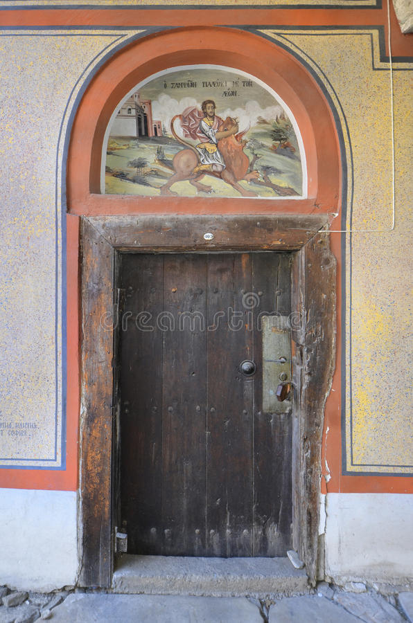 Bulgaria, Bachkovo. Bulgaria, door and wall painting in Bachkovo monastery, landmark and pilgrimage site royalty free stock images
