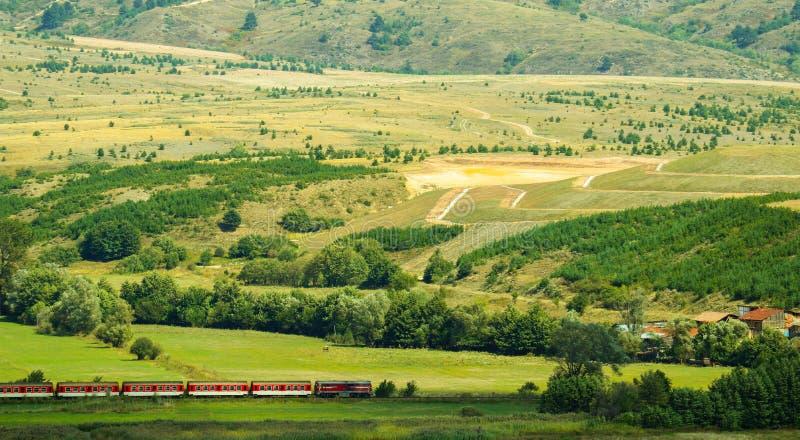 Bulgaria beautiful colorful meadow landscape, summertime, mountain train. Bulgarian narrow-gauge railway train. royalty free stock image