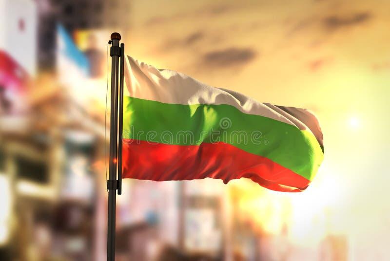 Bulgaria Flag Against City Blurred Background At Sunrise Backlight. Sky stock photo
