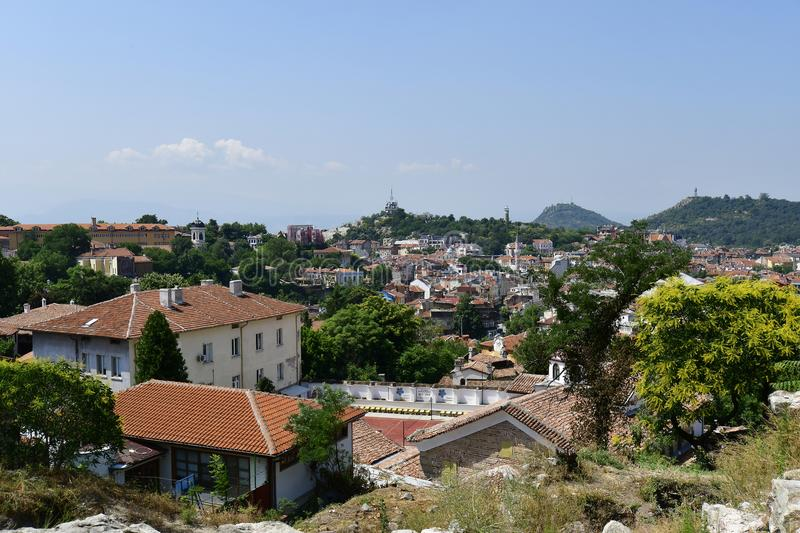 Bulgaria, Plovdiv, cityscape. Plovdiv, Bulgaria - June 08, 2018: Cityscape from Nebet hill with different buildings, dzhumaya mosque and clock tower, city became royalty free stock images