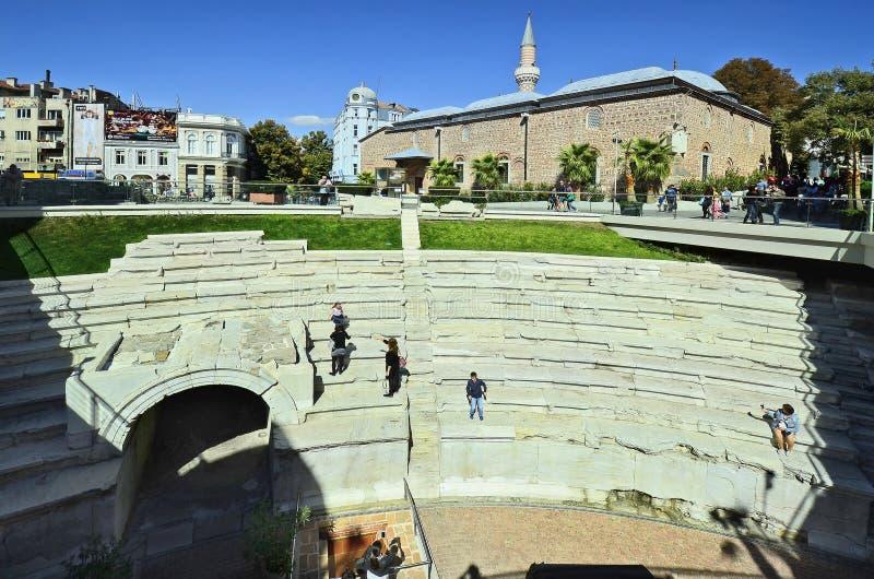 Bulgaria, Plovdiv. Plovdiv, Bulgaria - September 23, 2016: Unidenitfied people on Roman Stadium with Dzhumaya mosque, landmark and tourist attraction, city stock photos