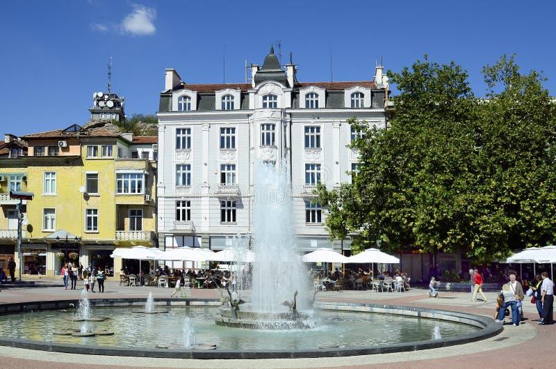 Bulgaria, Plovdiv. Plovdiv, Bulgaria - September 23, 2016: Unidentified poeple and buildings around fountain on Stefan Stambolov square in pedestrian precinct in stock photography