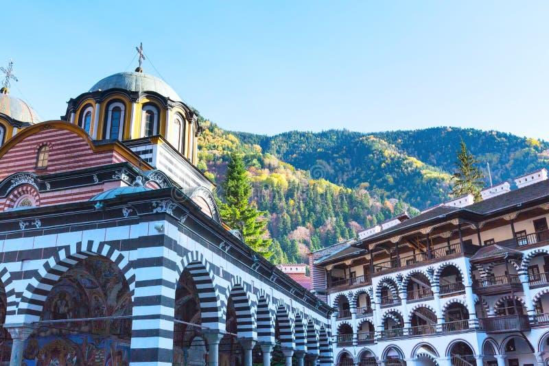 Rila Monastery, Bulgaria and autumn mountains royalty free stock photo