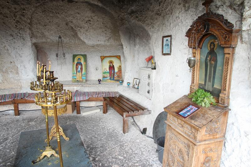 Bulgaria rock church. IVANOVO, BULGARIA - AUGUST 18, 2012: Interior view of Ivanovo rock hewn church in Bulgaria. The religious monument is listed as UNESCO royalty free stock photo