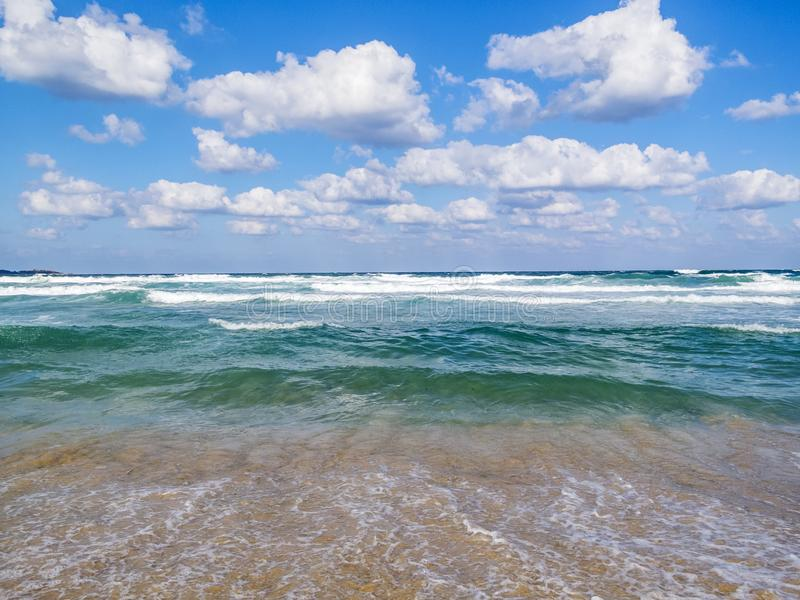 Bulgarian Black Sea water expanse view with fluffy Cumulus clouds in the sky royalty free stock photos