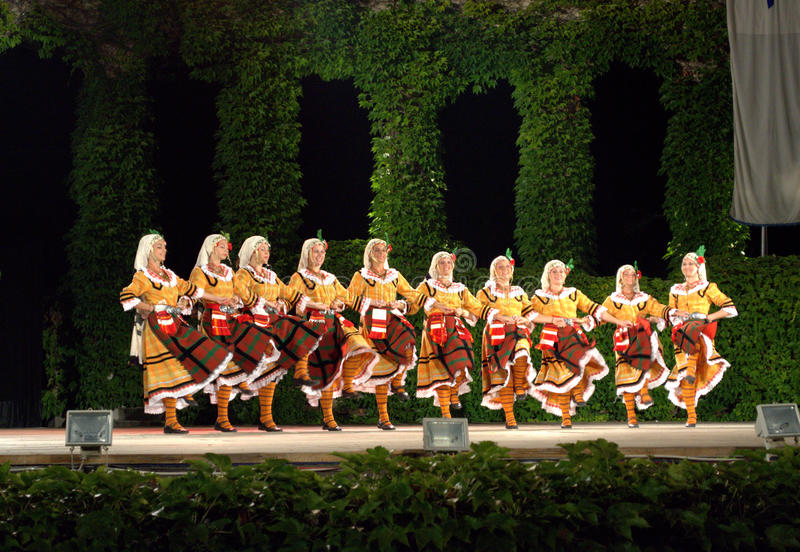 Bulgarian dancers at folklore festival stage royalty free stock photo