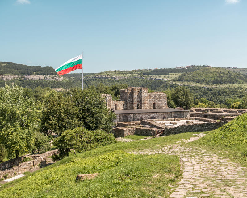 Bulgarian flag flying over ruins of medieval fortress. Tsarevets, Veliko Tarnovo, Bulgaria royalty free stock image