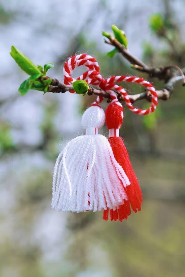 Bulgarian Martenitsa on the tree branch royalty free stock image