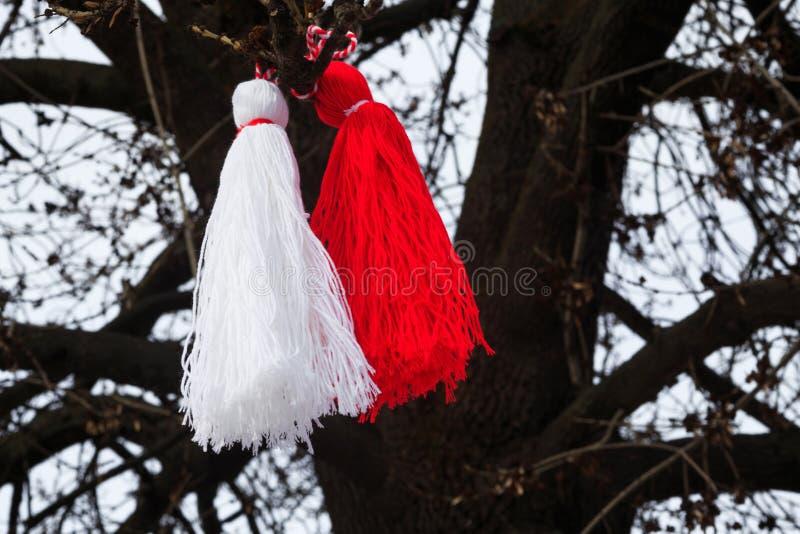Bulgarian martenitsa on a tree. Pizho and Penda Martenitsa, traditional Bulgarian spring custom royalty free stock image