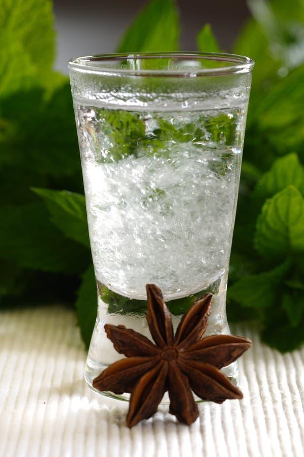 Bulgarian Mastika. Chilled mastika alkohol with aniseed flavour (tastes like greek ouzo royalty free stock photos