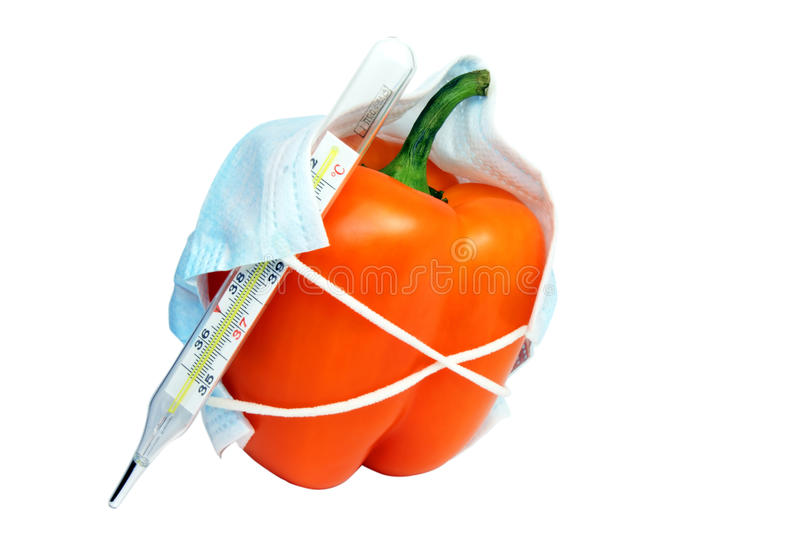 Bulgarian pepper in medical mask with thermometer royalty free stock photos