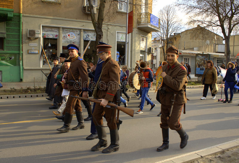 Bulgarian soldiers at carnival procession. People masked as Bulgarian soldiers and rebels from different historical periods in street procession of Varna stock photo