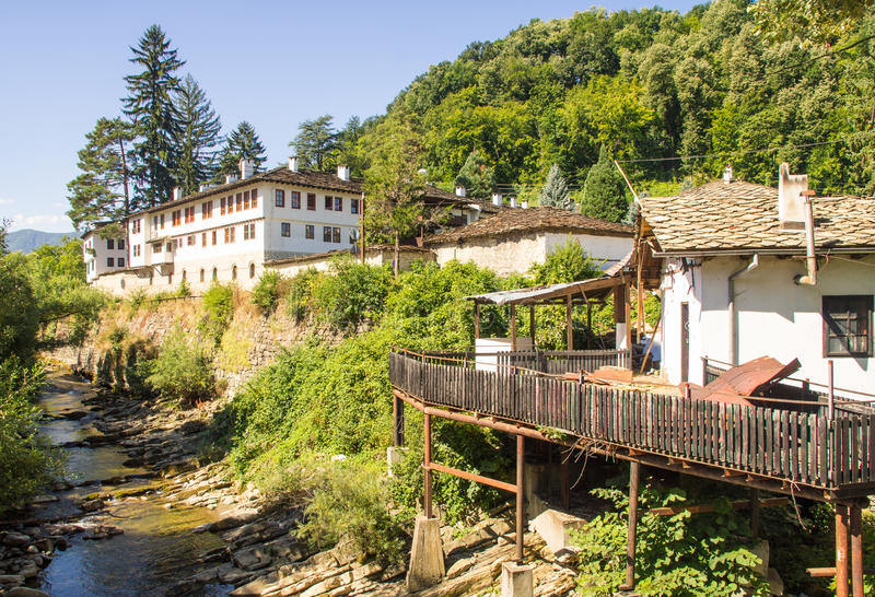 Bulgarian Troyan Monastery on the bank of the river Cherni Osam royalty free stock images