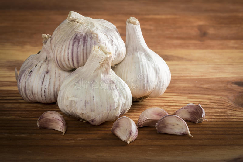 Image result for garlic on the wooden table