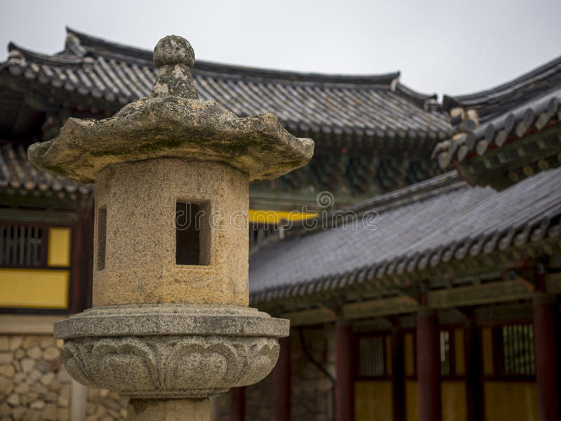 Bulguksa temple in Gyeongju, South Korea. Architectonic detail of Bulguksa temple in Gyeongju, South Korea. Lantern in the foreground, temple buildings in the stock images