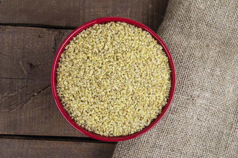 Bulgur, boiled and pounded wheat. turkish bulgur pictures, turkish bulgur in plates, bulgur pilaf to make. stock image