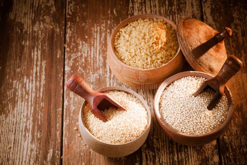 Bulgur, quinoa y cuscús imágenes de archivo libres de regalías