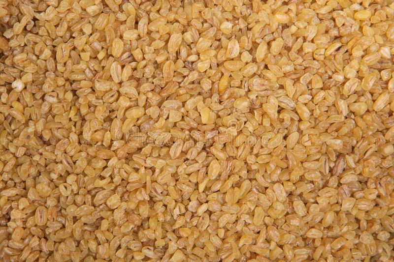 Bulgur wheat. Top view. Food Background. A scattering of bulgur wheat grains. Healthy food. Natural food royalty free stock image