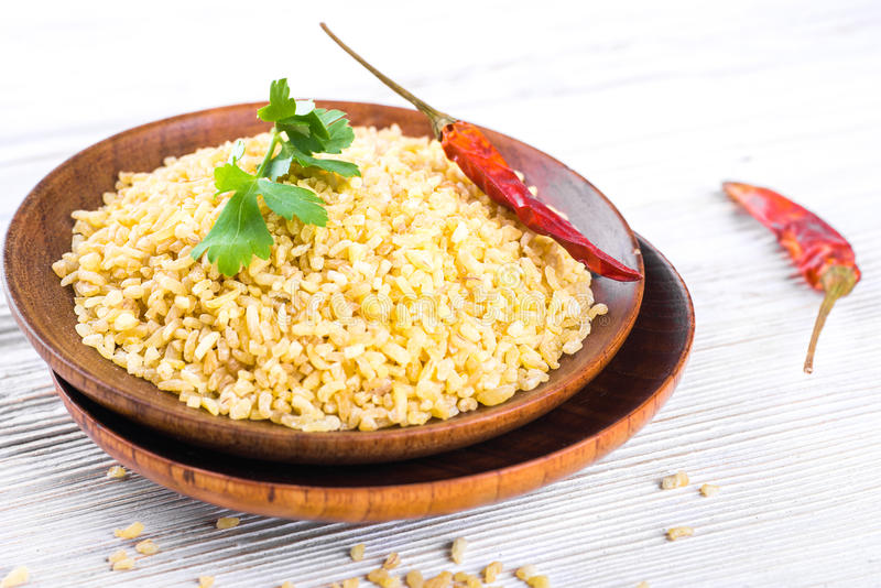 Download Bulgur in a wooden plate stock image. Image of isolated - 39513765