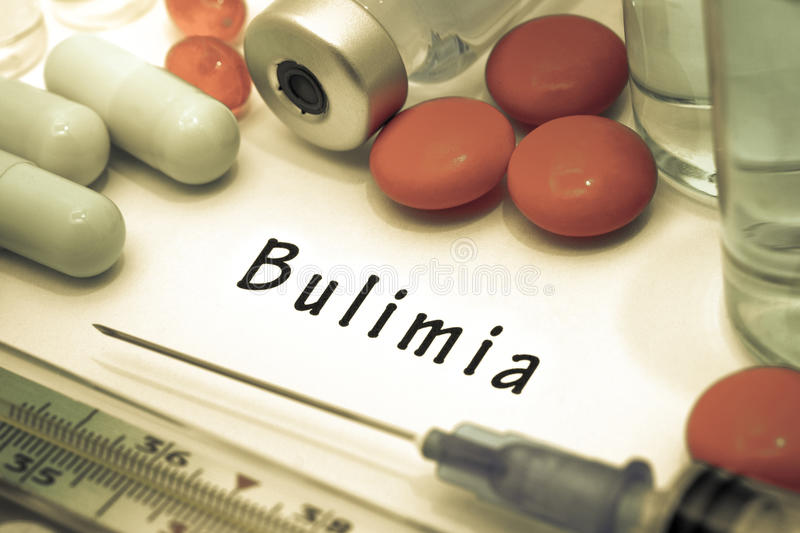 Bulimia. Diagnosis written on a white piece of paper. Syringe and vaccine with drugs stock image