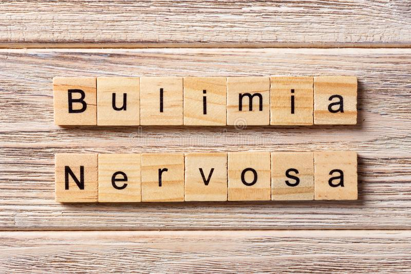 BULIMIA Nervosa word written on wood block. BULIMIA Nervosa text. On table, concept royalty free stock images