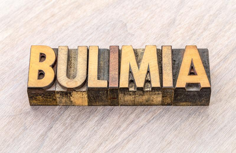 Bulimia word abstract in wood type. Bulimia - word abstract in vintage letterpress wood type printing blocks stock images