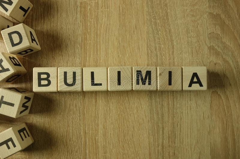Bulimia word from wooden blocks. On desk royalty free stock photo
