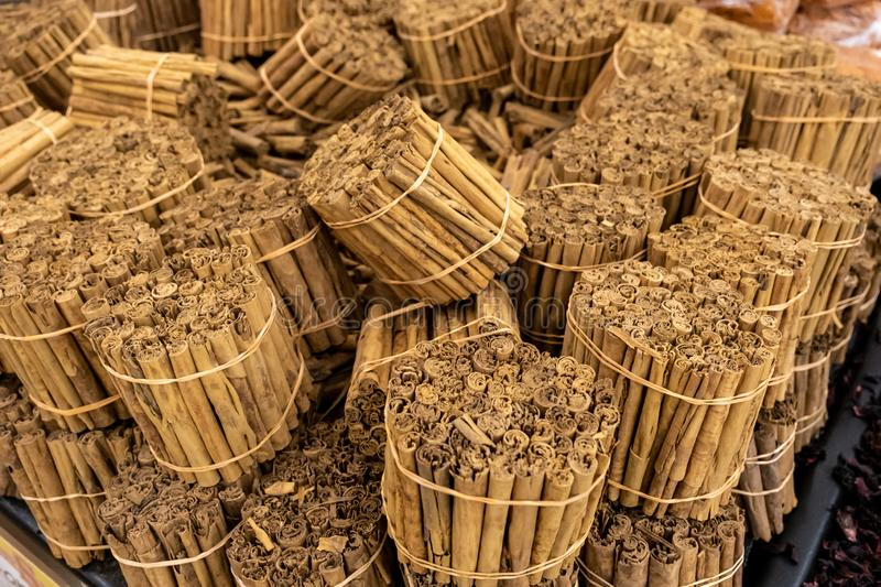 Bulk bunch of cinnamon sticks for sale stock image