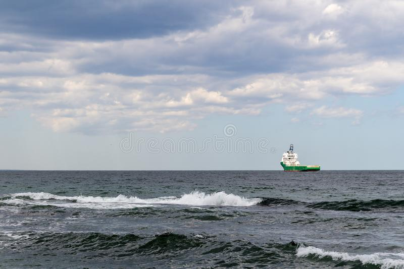 Bulk carrier cargo vessel  underway in the rough high seas.  stock photography
