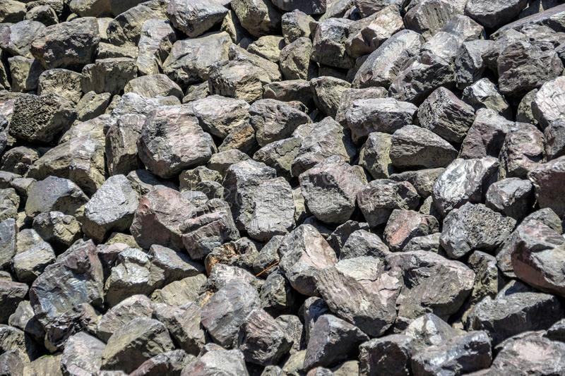 Bulk of coarse gravel on a harbour basin, texture and background. Germany royalty free stock photo
