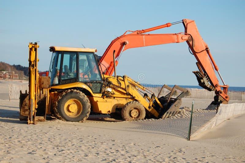 Bull dozers on sand stock image
