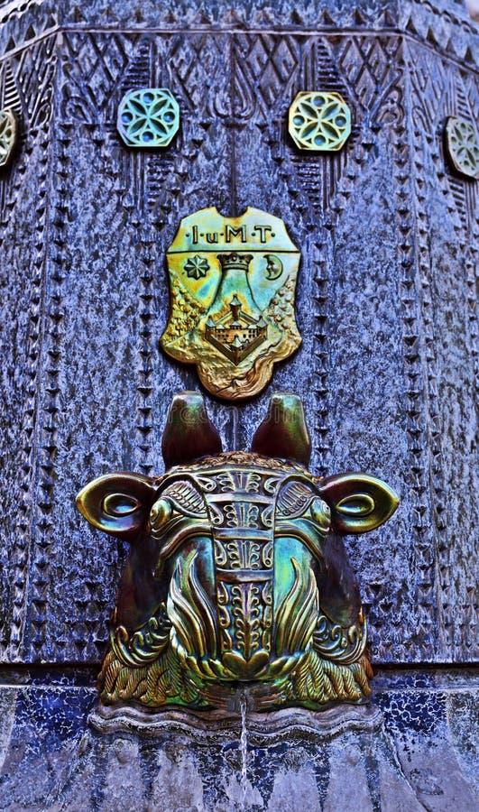 Zsolnay Fountain in Pécs, Hungary. Bull head of the Zsolnay Founatin close up in Pécs, Hungary stock photos