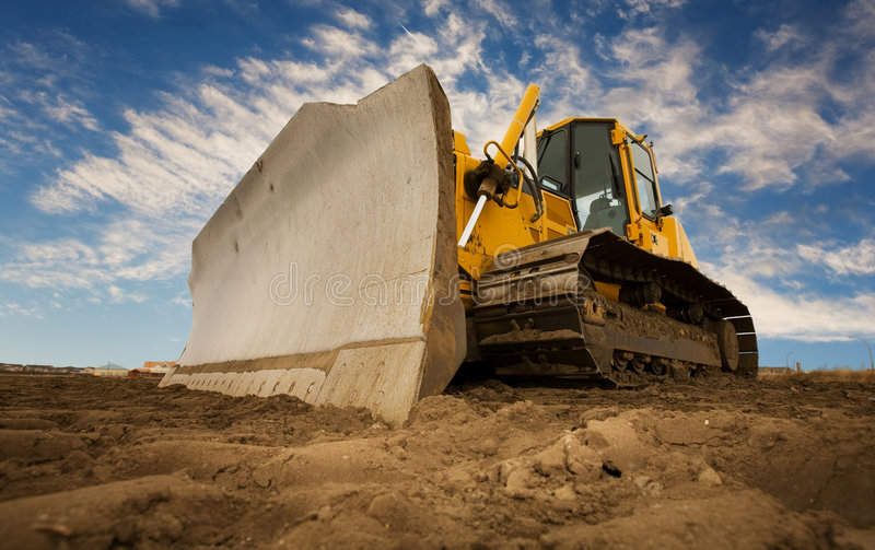 Bulldozer. A large yellow bulldozer at a construction site low angle view stock photography