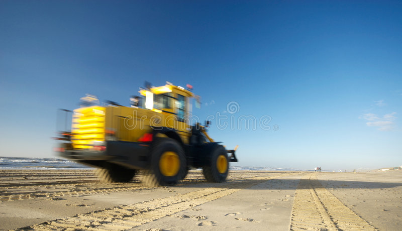 Bulldozer on beach royalty free stock photos