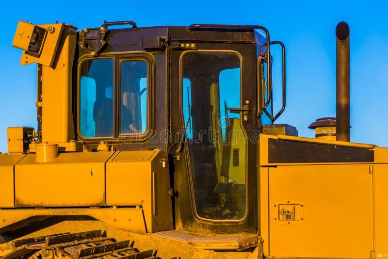 Bulldozer cabin, heavy groundwork machinery, ground moving equipment royalty free stock photo