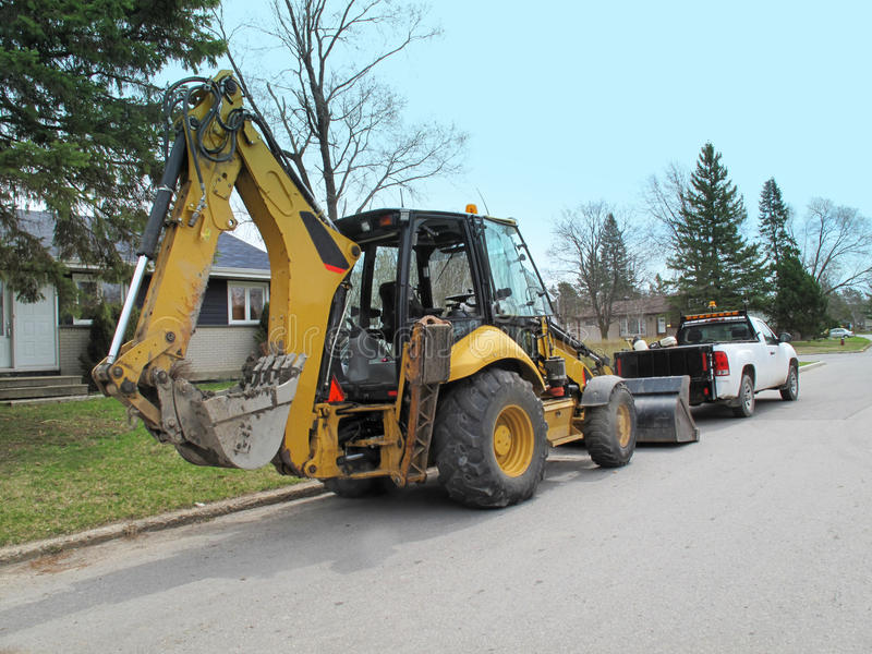 Download Bulldozer on city street stock image. Image of equipment - 31994295