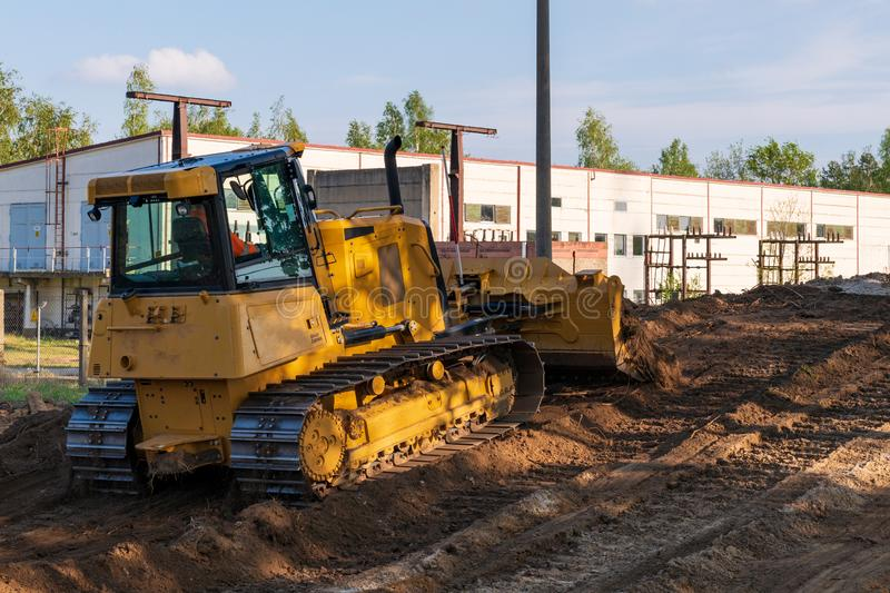 A bulldozer during clearing work royalty free stock image