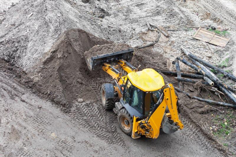 Bulldozer digging the ground. Repair of heating, bulldozer digging the ground stock images