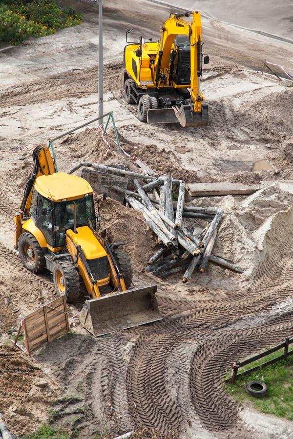 Bulldozer digging the ground. Repair of heating, bulldozer digging the ground royalty free stock photo