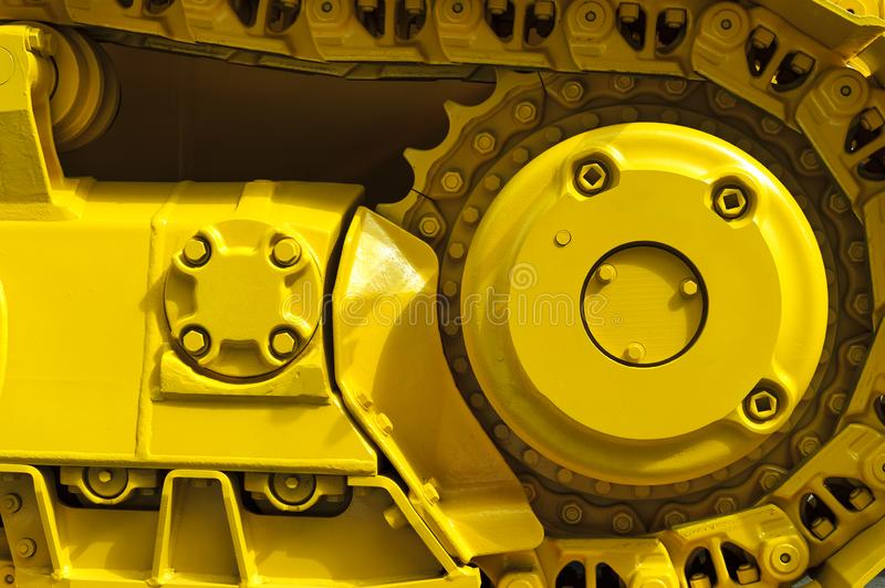 Bulldozer drive gear. Track drive gear, bulldozer sprocket mechanism, large yellow construction machine with bolts, heavy industry, detail stock image
