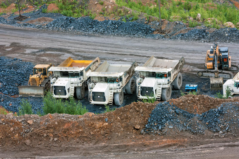 Bulldozer, dump trucks and excavator royalty free stock images