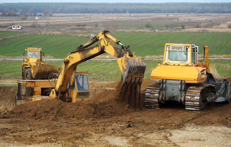 Bulldozer ed escavatore immagine stock libera da diritti