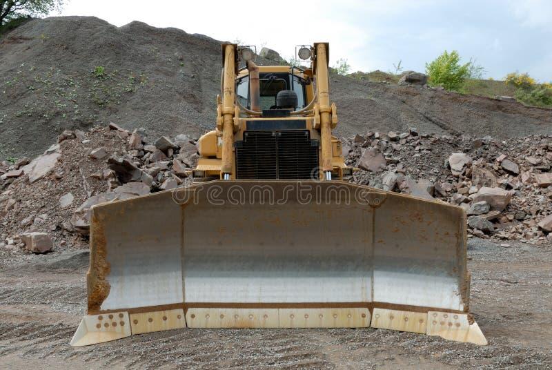 Bulldozer in een steenkuil royalty-vrije stock foto