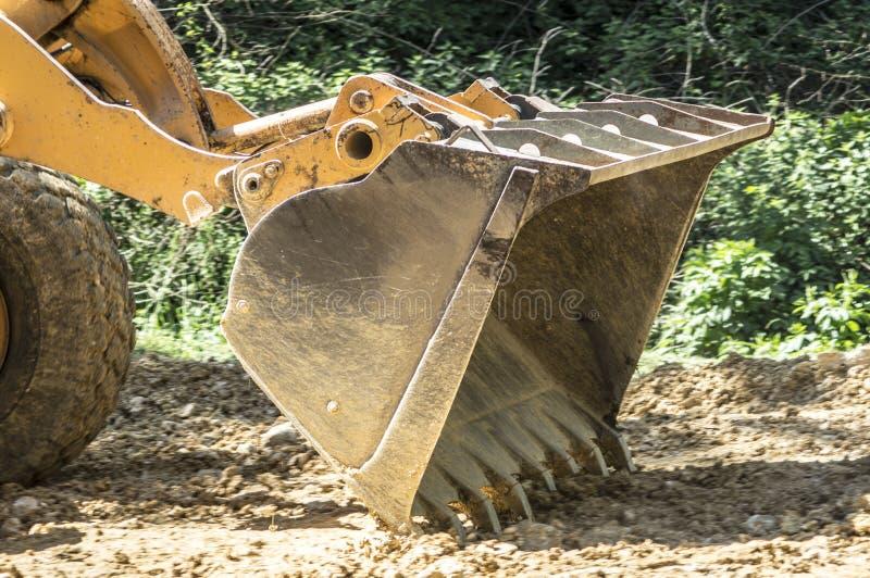 Bulldozer flattens road royalty free stock photos