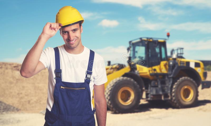 Bulldozer with handsome latin american construction worker stock images