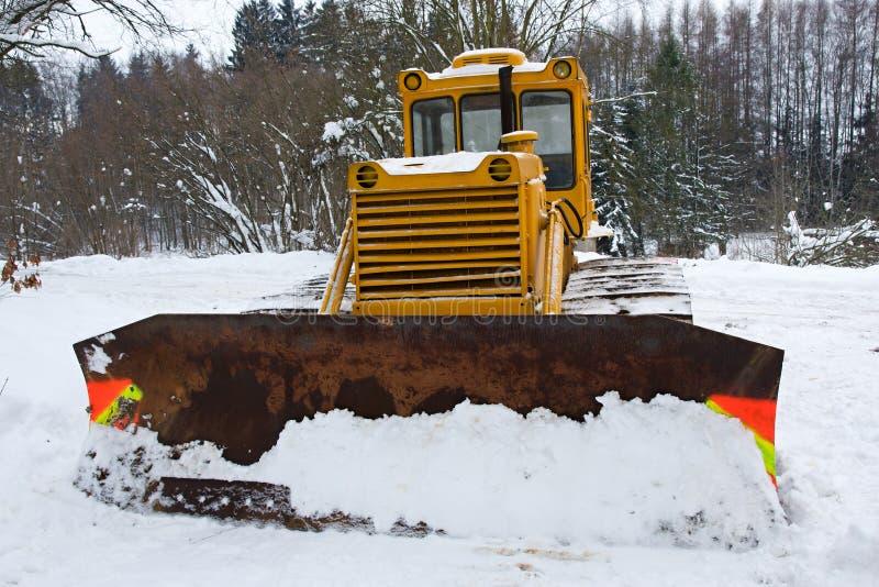 Bulldozer in inverno immagini stock