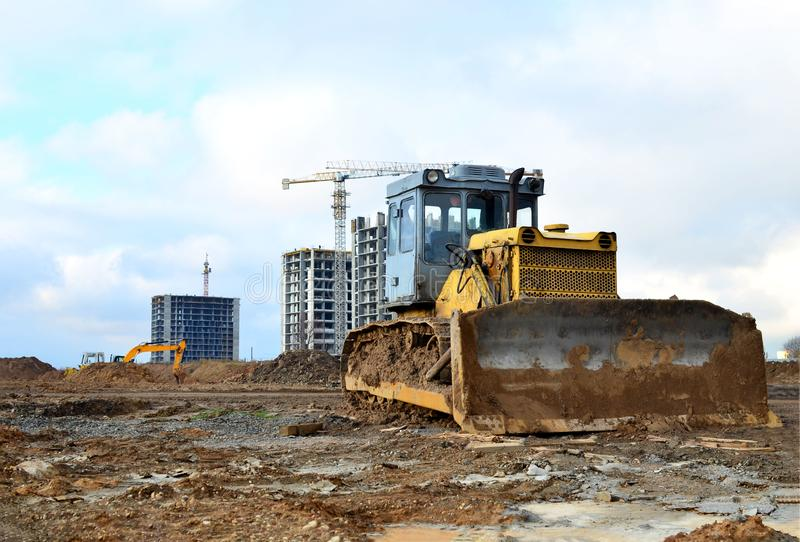 Bulldozer during of large construction jobs at building site. Land clearing, gr royalty free stock photos