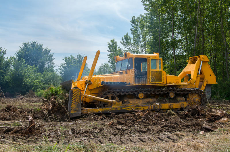 Bulldozer. Mechanical Site Preparation for Forestry. Heavy-duty construction for increased shearstress on tracts with increased roots and stumps stock photo