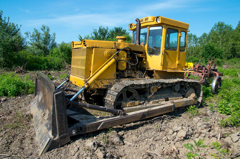 Bulldozer. Mechanical Site Preparation for Forestry. Heavy-duty construction for increased shearstress on tracts with increased roots and stumps stock photos